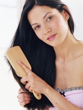 woman-with-black-hair-brushing-her-hair
